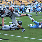 ORLANDO, FL - OCTOBER 24:  Jake Hescock #88 of the Central Florida Knights leaps into the end zone for a touchdown in front of defensive back Kyle Meyers #10 of the Tulane Green Wave at Bounce House-FBC Mortgage Field on October 24, 2020 in Orlando, Florida. (Photo by Alex Menendez/Getty Images) *** Local Caption *** Jake Hescock; Kyle Meyers
