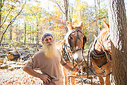 Robert Runyon stands with his mules Jasper and Jenny at their home in Sugar Tree Hollow in Winslow, Arkansas, for Out Here Magazine. Photo by Beth Hall