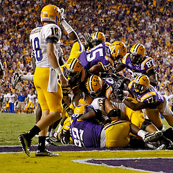 October 16, 2010; Baton Rouge, LA, USA; LSU Tigers players stop McNeese State Cowboys running back Andre Anderson (22) for a safety during the first half at Tiger Stadium. LSU defeated McNeese State 32-10. Mandatory Credit: Derick E. Hingle