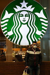 © Licensed to London News Pictures. 15/03/2020. London, UK. A man wearing a face mask outside Starbucks amid an increased number of coronavirus (COVID-19) cases in the UK. 21coronavirus victims have died and 820 cases have tested positive of the virus in the UK of which 167 in London. Photo credit: Dinendra Haria/LNP