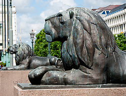 Bronze lions guarding canal in central Gothenburg Sweden