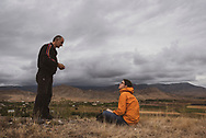 An Armenian man talks with a Swiss visitor on a hill above his village near Agdam in the disputed territory of Nagorno-Karabakh. (September 24, 2016)