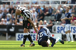 13 August 2017  : Premier League Football : Newcastle United v Tottenham Hotspur: Dele Alli of Tottenham rolls over in agony after a clash with Jonjo Shelvey:<br />  Photo: Mark Leech