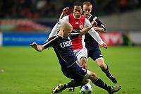seizoen 2008 / 2009 ,  31-01-2009 ajax - heerenveen urby emanuelson en bak nielsen achter is christian grindheim