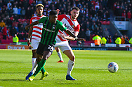 Bright Enobakhare of Coventry City (24) and Ben Whiteman of Doncaster Rovers (8) in action during the EFL Sky Bet League 1 match between Doncaster Rovers and Coventry City at the Keepmoat Stadium, Doncaster, England on 4 May 2019.