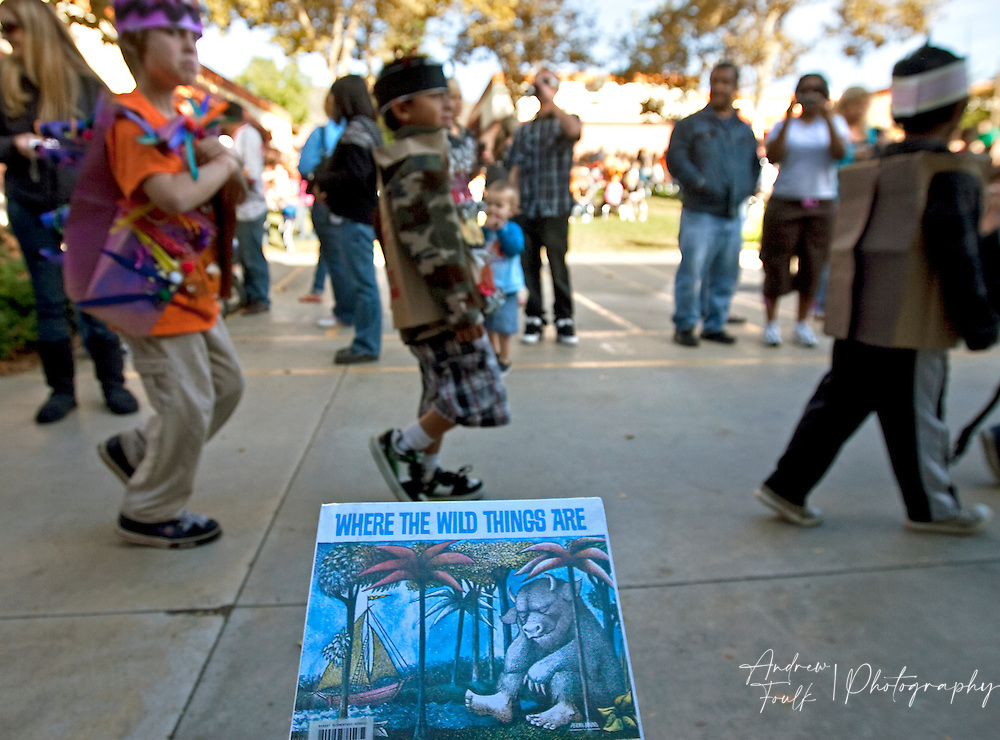 """/Andrew Foulk/ For The Californian/ .First graders at Avaxat Elementary scream and act like a wild animals as they walk past a copy of the book  """"Where the Wild Things Are"""" during the schools """"Wild Rumpus"""" where students dressed up as characters from the book."""