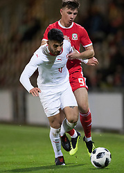 NEWPORT, WALES - Tuesday, October 16, 2018: Wales' Thomas Harris in action against Switzerland's Eray Cumart during the UEFA Under-21 Championship Italy 2019 Qualifying Group B match between Wales and Switzerland at Rodney Parade. (Pic by Laura Malkin/Propaganda)