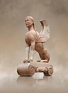 Archaic ancient Greek sculpture of a Sphinx originally on top of the column of Naxos, 570-560 BC, Delphi National Archaeological Museum.