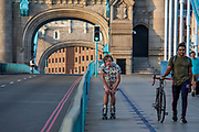 Skater keeping fit while practicing social distancing during the lockdown on Tower Bridge at 5pm on 9th April 2020 in London, United Kingdom. Normally crowded with people leaving work the City of London is like a ghost town as workers stay home during the Coronavirus pandemic.