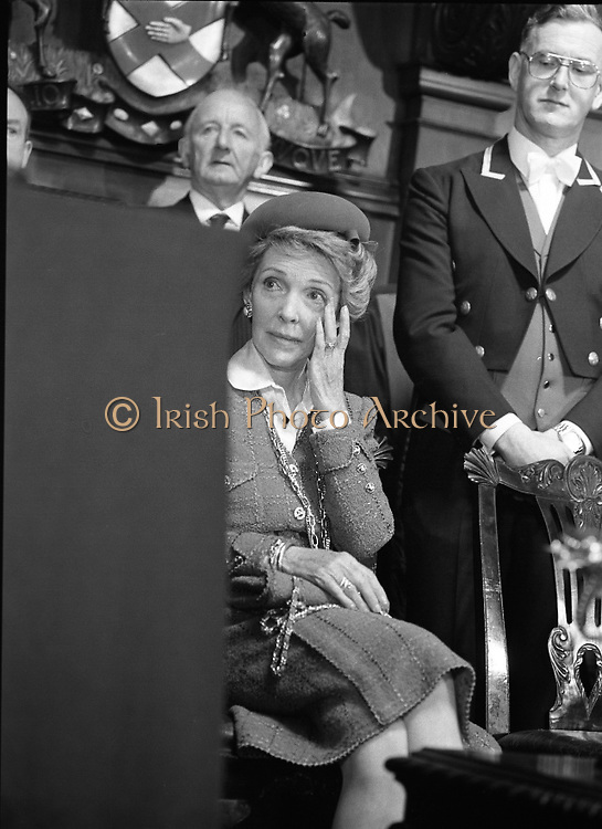 Nancy Reagan .Visits the Royal College Of Surgeons..St Stephens Green,.1984..04.06.1984.06.04.1984.4th June 1984..Nancy Reagan visited the Royal College of Surgeons where she unveilled a portrait of her late father.Her father, Dr Loyal Davis was an Honorary Fellow of the college. Mrs Reagan then presented the portrait to the college..Photo taken as Mrs Reagan wipes away a tear as Professor O'Malley relates a story about her father Dr Loyal Davis.