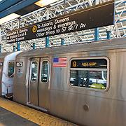 Q line train and platform on Coney Island subway station, Brooklyn, New York