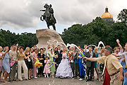 Saint Petersburg, Russia, 23/07/2005..Wedding parties on Decembrists Square by Palace Quay with the Bronze Horseman statue of Peter the Great behind.