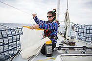 North Atlantic Ocean, September 2014.<br /> First mate Shanley McEntee holds a 200micron neuston net plankton tow, these trawls are used to gather samples on board the Sea Dragon.<br /> © Chiara Marina Grioni