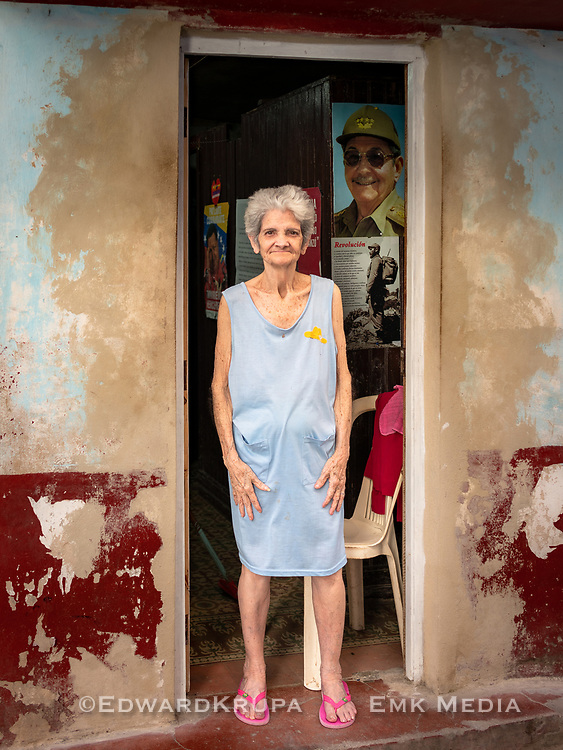 As proud revolutionary, this woman wanted to make sure that I capured the posters on the walls behind her, as she posed for me in the door of her home in Old Havana.