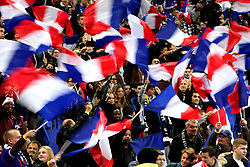 France fans wave flags in the stands prior to the International Friendly match at the Stade de France, Paris.