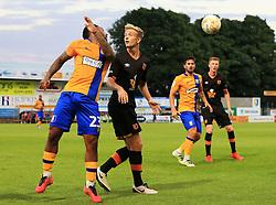 Ashley Hemmings of Mansfield flicks a header over Greg Olley of Hull City - Mandatory by-line: Matt McNulty/JMP - 19/07/2016 - FOOTBALL - One Call Stadium - Mansfield, England - Mansfield Town v Hull City - Pre-season friendly