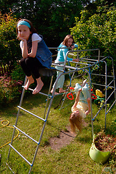 Girl sitting separately from her friends who are playing