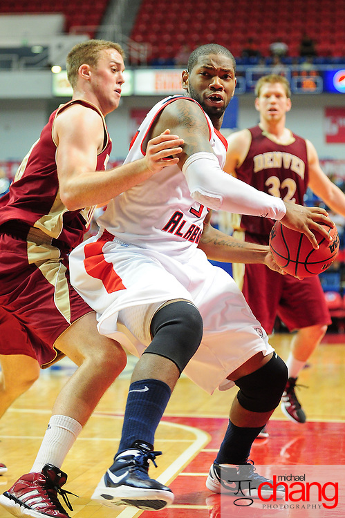 South Alabama's forward Antione Lundy (34) drives around a Denver player in the second half of play in Mobile, AL. Denver defeated South Alabama 67-50 on January 7, 2012.