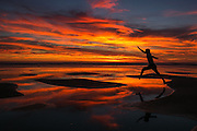 A brilliant sunset silhouettes a person jumping between sandbars at Shi Shi Beach on the Olympic Peninsula. <br /> <br /> Bettina Hansen / The Seattle Times