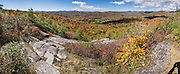 In mid October, enjoy vibrant fall foliage colors at Flat Rock Overlook on a 1.2-mile loop trail from Blue Ridge Parkway milepost 308.2 in Pisgah National Forest, North Carolina, USA. From Flat Rock Overlook, see Linville Valley and the Roan and Hump Mountains. This panorama was stitched from 9 overlapping photos from October 12, 2015.