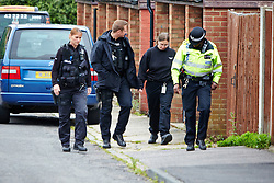 © Licensed to London News Pictures.  24/06/2013. AYLESBURY, UK. Armed police officers at the scene of a suspicious death in Aylesbury, Bucks. Thames Valley Police were called to a property in Belgrave Road, next to a local primary school,  at 10:43 last night (Sunday)and a man's body was found inside. The death is being treated as unexplained but suspicious. Photo credit: Cliff Hide/LNP