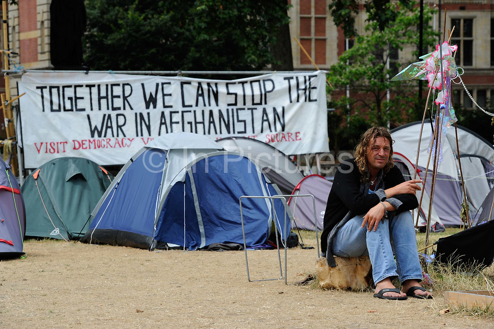 Members of the democracy village gather opposite The Houses of Parliament , London, July , 2010. The ragtag community of peace activists, pro-democracy campaigners and the homeless was torn  down by Baliffs and Police.