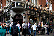 People outside the Nags Head pub. Covent Garden in the West End of London.