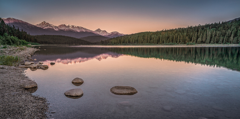 Lakeside reflections during a breathtaking morning in Jasper National Park.