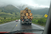 Quito- Sunday, Dec 09 2007: A lorry loaded with logged tree trunks heads south towards Quito. (Photo by Peter Horrell / http://www.peterhorrell.com)