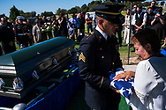 Army National Guard Honor Guard Sgt. Michael Trujillo, left, presents an American flag to Graciela Lopez, 77, during the burial services of her son, Jose Raúl López Jiménez, 52, in Hobbs, New Mexico, Saturday, Oct. 5, 2019.<br /> <br /> Jose Raúl López Jiménez was born in Chihuahua, Chihuahua, México and later entered the United States at young age gaining his green card. He enlisted in the U.S. Army in 1980 serving active duty through 1983 with an honorable discharge. López was convicted of a felony narcotics conviction which he served and completed six months in prison for. While out on on his parole, he reported to his regular appearance dates for parole where he was detained by immigration officials. He spent another six months in immigration detention and was eventually deported to México in 2008.<br /> <br /> The López family has had to bury three of their loved ones in less than a year. Graciela, López's mother, had to bury her husband in January, her mother in July and now her son in October of this year.
