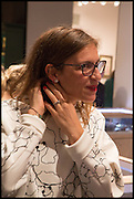 MAIA MORGENSZTERN trying on earrings at the preview of LAPADA Art and Antiques Fair. Berkeley Sq. London. 23 September 2014.