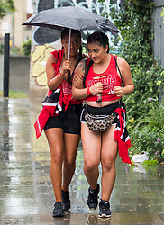 © Licensed to London News Pictures. 26/08/2018. London, UK. Carnival goers brave the wet and windy conditions at family day of the 2018 Notting Hill Carnival. Up to 1 million people are expected to attend this weekend's event that is one of the worlds largest street festivals. Photo credit: Ben Cawthra/LNP