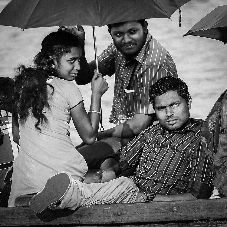 Three idians spending spare time on a small boat in India.