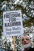 A man holds a Freedom For Kashmir placard during a Pro Kashmir protest at Parliament Square on the 3rd September 2019 in London in the United Kingdom. Protesters gather near the statue of Mahatma Gandhi in solidarity following Indian Prime Minister Narendra Modi's Independence Day speech removing special rights of Kashmir as an autonomous region.