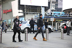 January 3, 2018 - New York, New York, U.S. - Pedestrians walk past metal bollards in Times Square. New York city plans to install 1,500 new security barriers in high-profile locations to guard against vehicle attacks and other terror-related incidents. The metal bollards will replace some of the concrete cubes and barriers that have been placed as temporary measures near pedestrian areas. (Credit Image: © Wang Ying/Xinhua via ZUMA Wire)