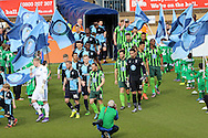 Wycombe Wanderers and AFC Wimbledon players enter the pitch from the tunnel for the start of the match. Skybet football league two match, Wycombe Wanderers  v AFC Wimbledon at Adams Park  in High Wycombe, Buckinghamshire on Saturday 2nd April 2016.<br /> pic by John Patrick Fletcher, Andrew Orchard sports photography.