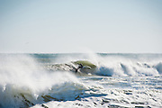 Seawall Surf in Narragansett, Rhode Island, during deep winter surf.