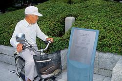 Man Viewing Memorial Plaque