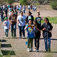052313       Brian Leddy<br />  Students, teachers and parents walk the dirt track at Gallup Catholic school Friday morning.  The school held a walk-a-thon to help raise money for the victims of the tornado in Moore, Okla.