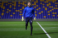 AFC Wimbledon goalkeeper Connal Trueman (1) warming up prior to kick off during the EFL Sky Bet League 1 match between AFC Wimbledon and Peterborough United at Plough Lane, London, United Kingdom on 2 December 2020.