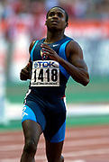 Tim Montgomery of the United States in the second round of the 100 meters in the IAAF World Championships in Athletics at Stade de France on Sunday, Aug, 24, 2003.