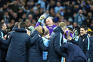Manchester City Goalkeeper Wilfredo Caballero shows his delight as he is lifted up after his performance in goal for the penalty shoot out as Man city celebrate their win. Capital One Cup Final, Liverpool v Manchester City at Wembley stadium in London, England on Sunday 28th Feb 2016. pic by Chris Stading, Andrew Orchard sports photography.