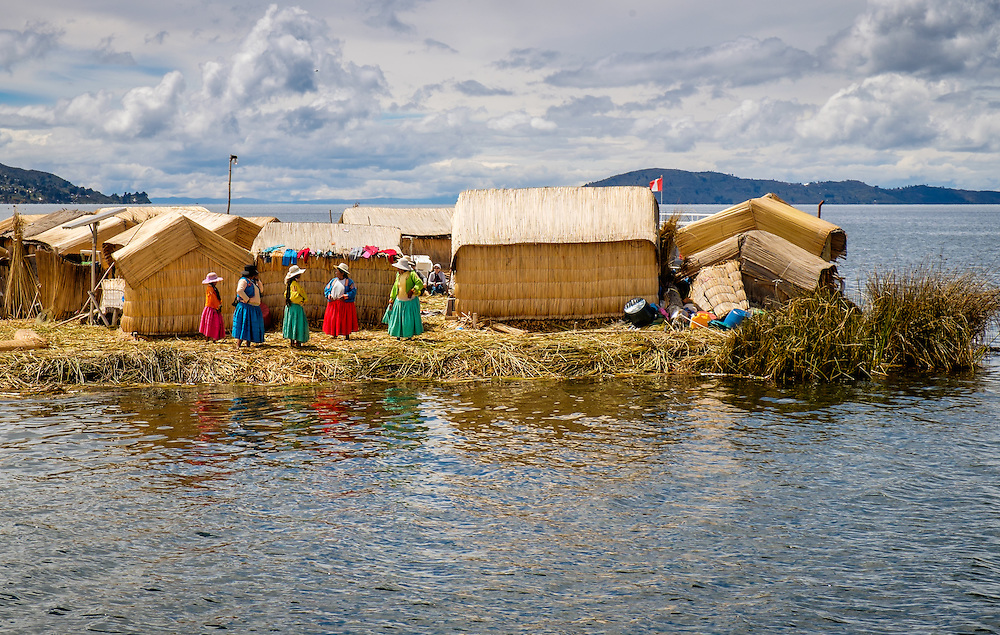 UROS ISLANDS, PERU - CIRCA APRIL 2014: Women from the Uros Islands in Lake Titicaca waiting for tourists to arrive.