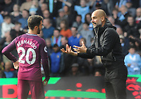 Football - 2017 / 2018 Premier League - Watford vs. Manchester City<br /> <br /> Manchester City Manager Pep Guardiola explains tactics with Bernardo Silva, at Vicarage Road.<br /> <br /> COLORSPORT/ANDREW COWIE