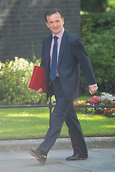 Welsh Secretary Alun Cairns arrives at 10 Downing Street in London for a Cabinet meeting.