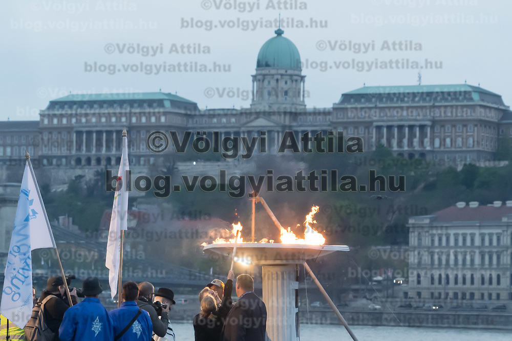Agnes Keleti (C) five times Hungarian Olympic champion  gymnast and Holocaust survivor lights a temporary flame after the March of the Living commemorating the events of the Holocaust in downtown Budapest, Hungary on April 14, 2019. ATTILA VOLGYI