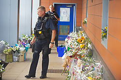 ©Licensed to London News Pictures 29/09/2020  <br /> Croydon, UK. A police officer looks at the flowers for Sgt Matt Ratana at Croydon Custody Centre. The murder investigation continues after the death of police sergeant Matt Ratana at the Croydon Custody Centre in South London last week. Photo credit:Grant Falvey/LNP