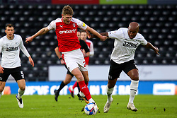 Andre Wisdom of Derby County challenges Michael Smith of Rotherham United for possession - Mandatory by-line: Ryan Crockett/JMP - 16/01/2021 - FOOTBALL - Pride Park Stadium - Derby, England - Derby County v Rotherham United - Sky Bet Championship