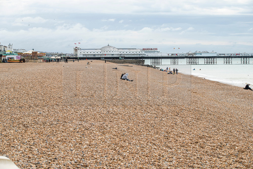 © Licensed to London News Pictures. 27/09/2020. Brighton, UK. Only a handful of visitors can be seen on the beach in Brighton and Hove as cold and grey weather is hitting the seaside resort. Photo credit: Hugo Michiels/LNP