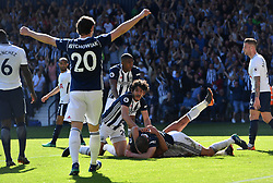 West Bromwich Albion's Jake Livermore (bottom) celebrates scoring his side's first goal of the game with team mates during the Premier League match at The Hawthorns, West Bromwich.